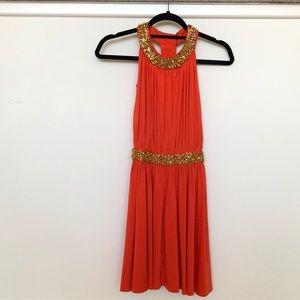 bold orange party dress with gold beading
